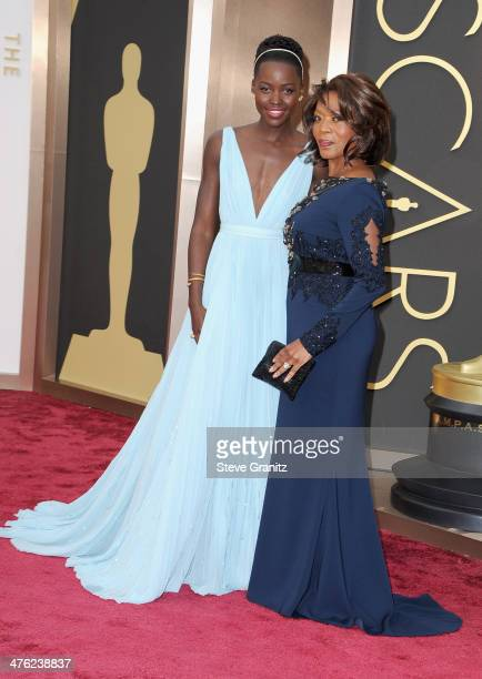 Actresses Lupita Nyong'o and Alfre Woodard attend the Oscars held at Hollywood Highland Center on March 2 2014 in Hollywood California