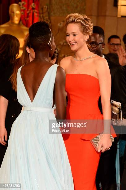 Actresses Lupita Nyong'o and Jennifer Lawrence attend the Oscars held at Hollywood Highland Center on March 2 2014 in Hollywood California