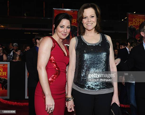 Actresses Lynn Collins and Sigourney Weaver arrive at the Walt Disney Presents 'John Carter' premiere held at Regal Cinemas LA Live on February 22...
