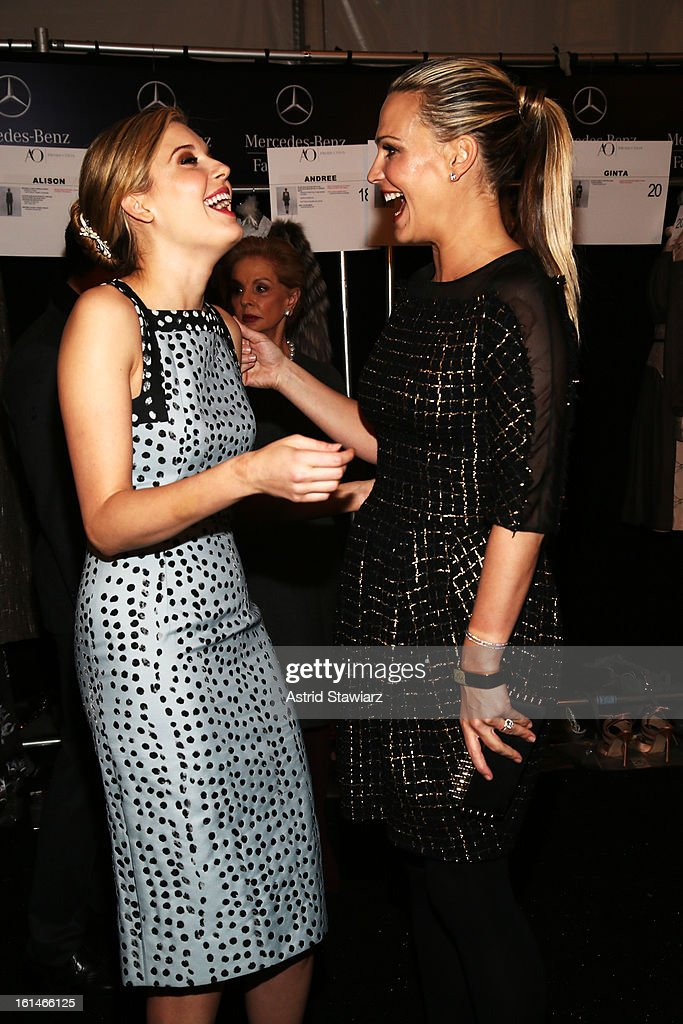 Actresses <a gi-track='captionPersonalityLinkClicked' href=/galleries/search?phrase=Maggie+Grace&family=editorial&specificpeople=213706 ng-click='$event.stopPropagation()'>Maggie Grace</a> and <a gi-track='captionPersonalityLinkClicked' href=/galleries/search?phrase=Molly+Sims&family=editorial&specificpeople=202547 ng-click='$event.stopPropagation()'>Molly Sims</a> attend the Carolina Herrera Fall 2013 fashion show during Mercedes-Benz Fashion Week at The Theatre at Lincoln Center on February 11, 2013 in New York City.