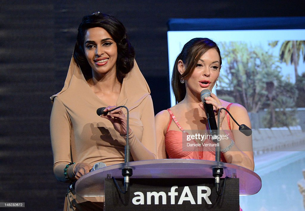 Actresses <a gi-track='captionPersonalityLinkClicked' href=/galleries/search?phrase=Mallika+Sherawat&family=editorial&specificpeople=233692 ng-click='$event.stopPropagation()'>Mallika Sherawat</a> and <a gi-track='captionPersonalityLinkClicked' href=/galleries/search?phrase=Rose+McGowan&family=editorial&specificpeople=206451 ng-click='$event.stopPropagation()'>Rose McGowan</a> speak at the 2012 amfAR's Cinema Against AIDS during the 65th Annual Cannes Film Festival at Hotel Du Cap on May 24, 2012 in Cap D'Antibes, France.