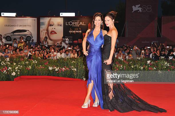 Actresses Manuela Arcuri and Asia Argento attend the 'Carnage' premiere at the Palazzo Del Cinema during the 68th Venice Film Festival on September 1...