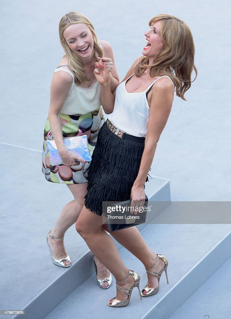 Actresses Mareille Hoeppner and Janin Reinhardt attend the Marc Cain show during the Mercedes-Benz Fashion Week Berlin Spring/Summer 2016 at Brandenburg Gate on July 7, 2015 in Berlin, Germany.