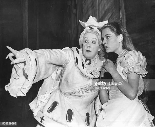 Actresses Margaret Rutherford as the 'White Queen' and Carol Marsh as 'Alice' pictured in costume during rehearsals for the play 'Alice Through the...