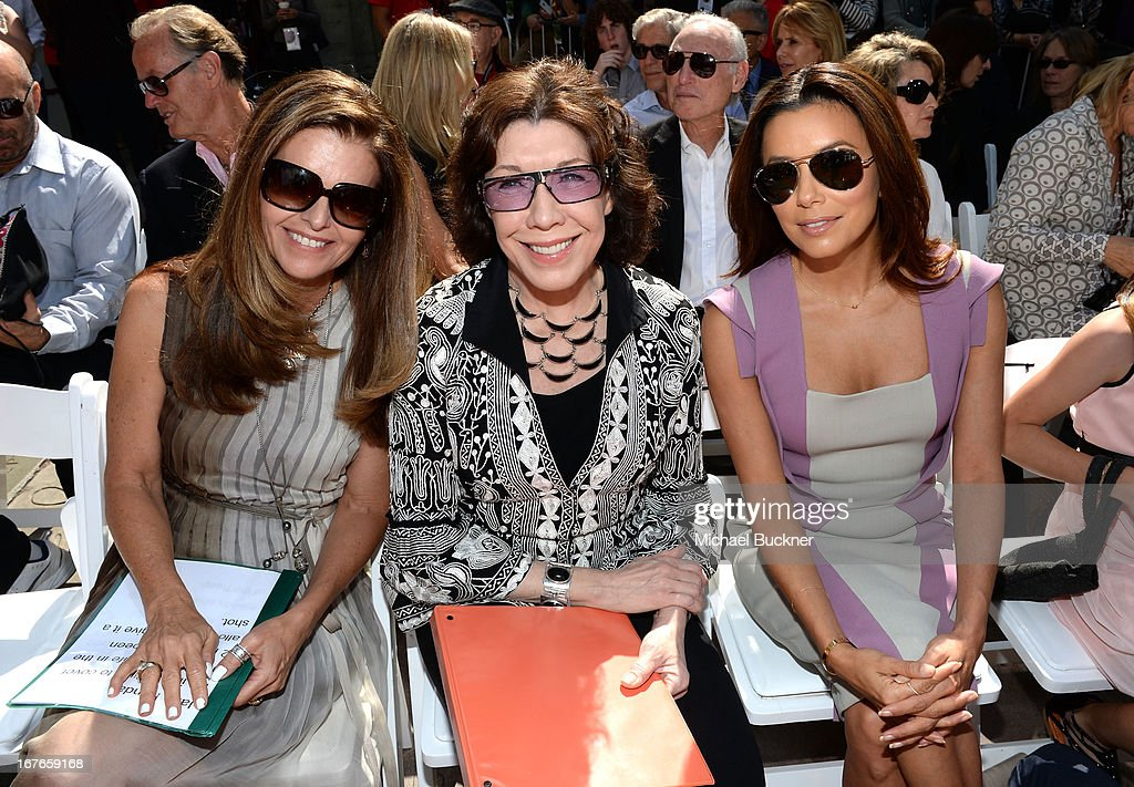 Actresses <a gi-track='captionPersonalityLinkClicked' href=/galleries/search?phrase=Maria+Shriver&family=editorial&specificpeople=179436 ng-click='$event.stopPropagation()'>Maria Shriver</a>, <a gi-track='captionPersonalityLinkClicked' href=/galleries/search?phrase=Lily+Tomlin&family=editorial&specificpeople=208236 ng-click='$event.stopPropagation()'>Lily Tomlin</a> and <a gi-track='captionPersonalityLinkClicked' href=/galleries/search?phrase=Eva+Longoria&family=editorial&specificpeople=202082 ng-click='$event.stopPropagation()'>Eva Longoria</a> attend actress Jane Fonda's Handprint/Footprint Ceremony during the 2013 TCM Classic Film Festival at TCL Chinese Theatre on April 27, 2013 in Los Angeles, California. 23632_009_MB_0525.JPG