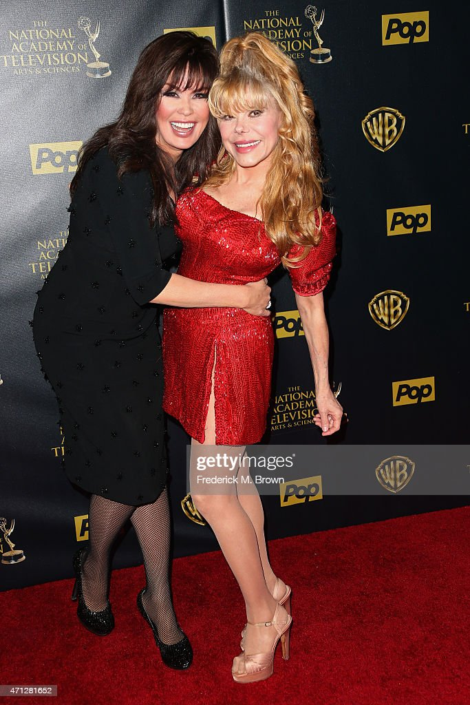 Actresses Marie Osmond and Charo pose in the press room during The 42nd Annual Daytime Emmy Awards at Warner Bros Studios on April 26 2015 in Burbank...