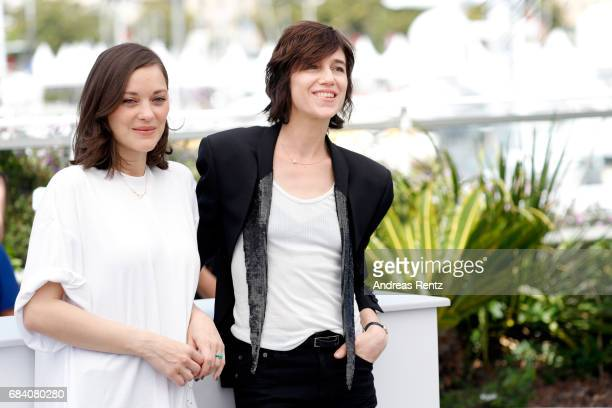 Actresses Marion Cotillard and Charlotte Gainsbourg attend the 'Ismael's Ghosts ' photocall during the 70th annual Cannes Film Festival at Palais des...