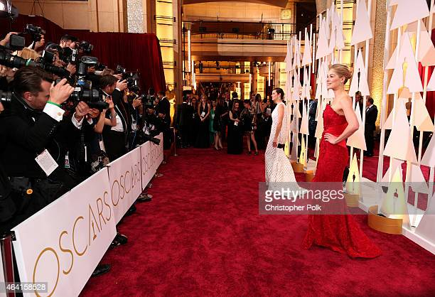 Actresses Marion Cotillard and Rosamund Pike attend the 87th Annual Academy Awards at Hollywood Highland Center on February 22 2015 in Hollywood...