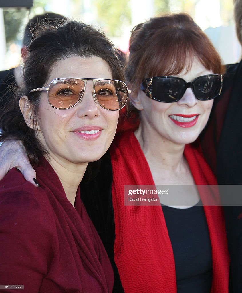 Actresses Marisa Tomei (L) and Frances Fisher attend the kick-off for One Billion Rising in West Hollywood on February 14, 2013 in West Hollywood, California.
