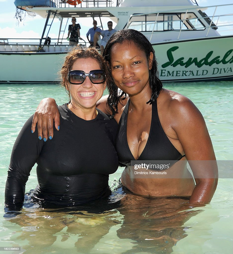 Actresses Marissa Jaret Winokur (L) and Garcelle Beauvais attend the Island Routes Caribbean Adventures during Day Two of the Sandals Emerald Bay Celebrity Getaway And Golf Weekend on September 28, 2013 at Sandals Emerald Bay in Great Exuma, Bahamas.