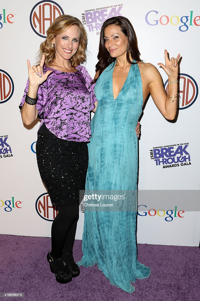 Actresses <a gi-track='captionPersonalityLinkClicked' href=/galleries/search?phrase=Marlee+Matlin&family=editorial&specificpeople=173454 ng-click='$event.stopPropagation()'>Marlee Matlin</a> (L) and <a gi-track='captionPersonalityLinkClicked' href=/galleries/search?phrase=Constance+Marie&family=editorial&specificpeople=204646 ng-click='$event.stopPropagation()'>Constance Marie</a> arrive at the National Association Of The Deaf's 1st annual Breakthrough Awards at Hollywood Roosevelt Hotel on March 13, 2014 in Hollywood, California.