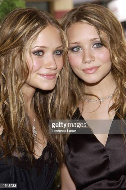 Actresses Mary Kate and Ashley Olsen arrive on May 17 2002 for the 29th Annual Daytime Emmy Awards at Madison Square Gardens'' Theater in New York...