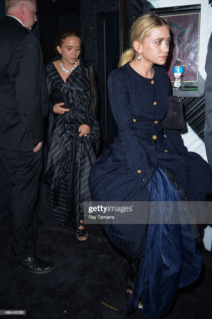 Actresses Mary-Kate Olsen (L) and Ashley Olsen leave the 'Charles James: Beyond Fashion' Costume Institute Gala after party at Up & Down on May 5, 2014 in New York City.