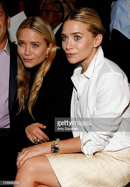 Actresses MaryKate Olsen and Ashley Olsen pose at FIJI Water at the J Mendel Spring 2012 show during MercedesBenz Fashion Week on September 14 2011...