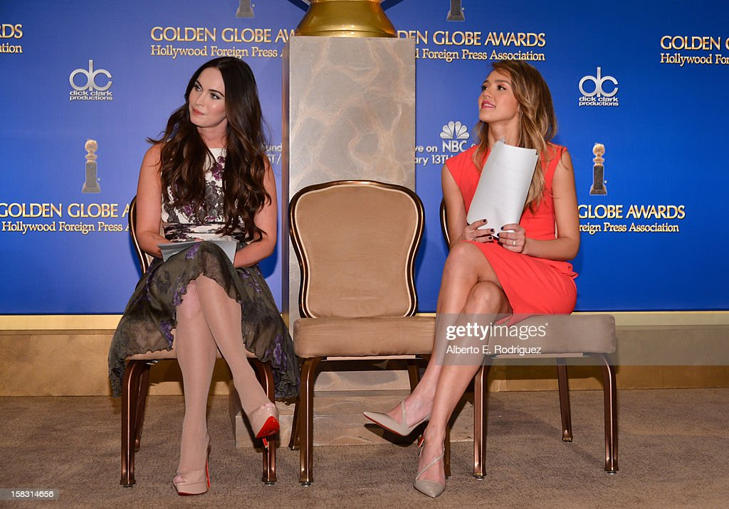 Actresses Megan Fox (L) and Jessica Alba speak onstage at the 70th Annual Golden Globe Awards Nominations held at The Beverly Hilton Hotel on December 13, 2012 in Beverly Hills, California.