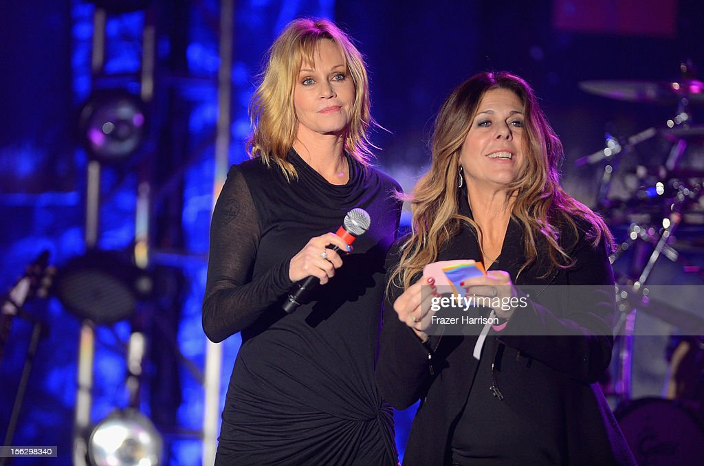 Actresses Melanie Griffith and Rita Wilson perform onstage at the St. John's Health Center's Power Of Pink benefiting The Margie Petersen Breast Center at Sony Studios on November 12, 2012 in Los Angeles, California.