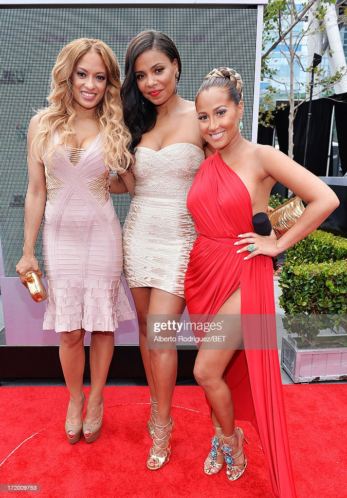 Actresses Melissa De Sousa, Sanaa Lathan, and Adrienne Bailon attend the P&G Red Carpet Style Stage at the 2013 BET Awards at Nokia Theatre L.A. Live on June 30, 2013 in Los Angeles, California.