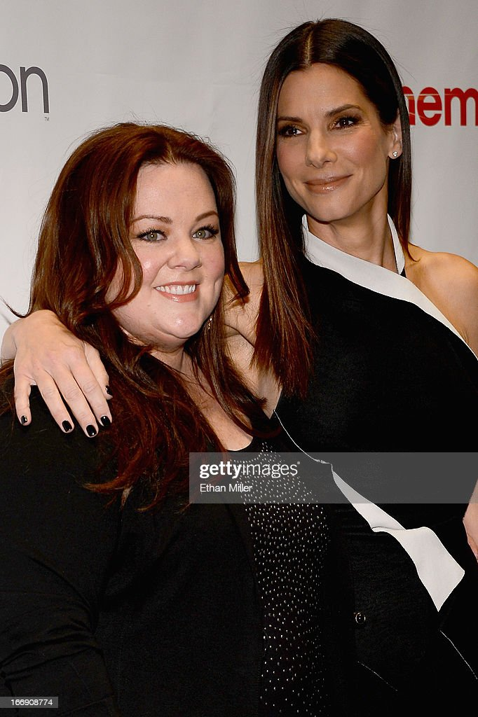 Actresses Melissa McCarthy (L) and Sandra Bullock arrive at a Twentieth Century Fox presentation to promote the upcoming film 'The Heat' at Caesars Palace during CinemaCon, the official convention of the National Association of Theatre Owners, on April 18, 2013 in Las Vegas, Nevada.