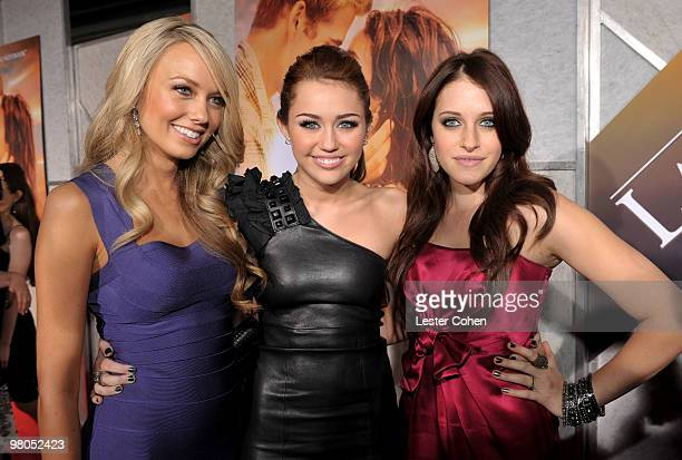 Actresses Melissa Ordway Miley Cyrus and Carly Chaikin arrive at the 'The Last Song' Los Angeles premiere held at ArcLight Hollywood on March 25 2010...