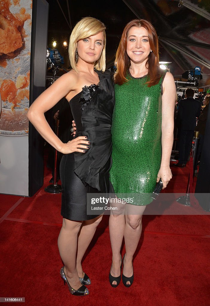 Actresses Mena Suvari and Alyson Hannigan arrive at the 'American Reunion' Los Angeles Premiere March 19 2012 in Hollywood California