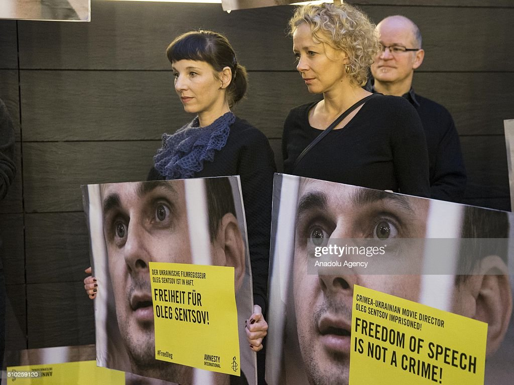 Actresses Meret Becker (L) and Katja Rieman (R) take part in a protest for the release of Ukrainian director Oleg Sentsov during the 66th annual Berlin International Film Festival, in Berlin, Germany, 14 February 2016.