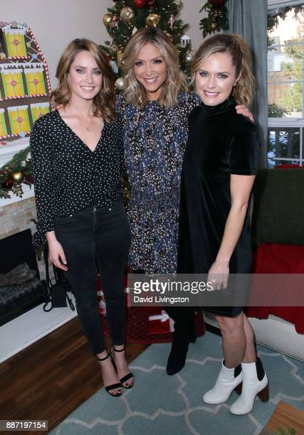 Actresses Merritt Patterson and Maggie Lawson pose with host Debbie Matenopoulos at Hallmark's 'Home Family' at Universal Studios Hollywood on...