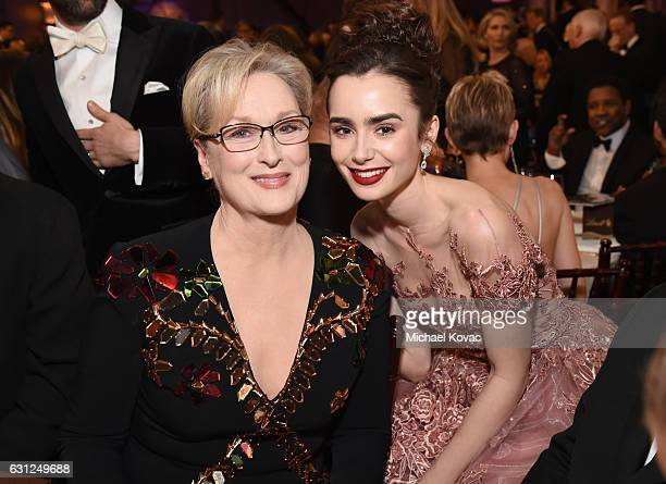 Actresses Meryl Streep and Lily Collins attend the 74th Annual Golden Globe Awards at The Beverly Hilton Hotel on January 8 2017 in Beverly Hills...