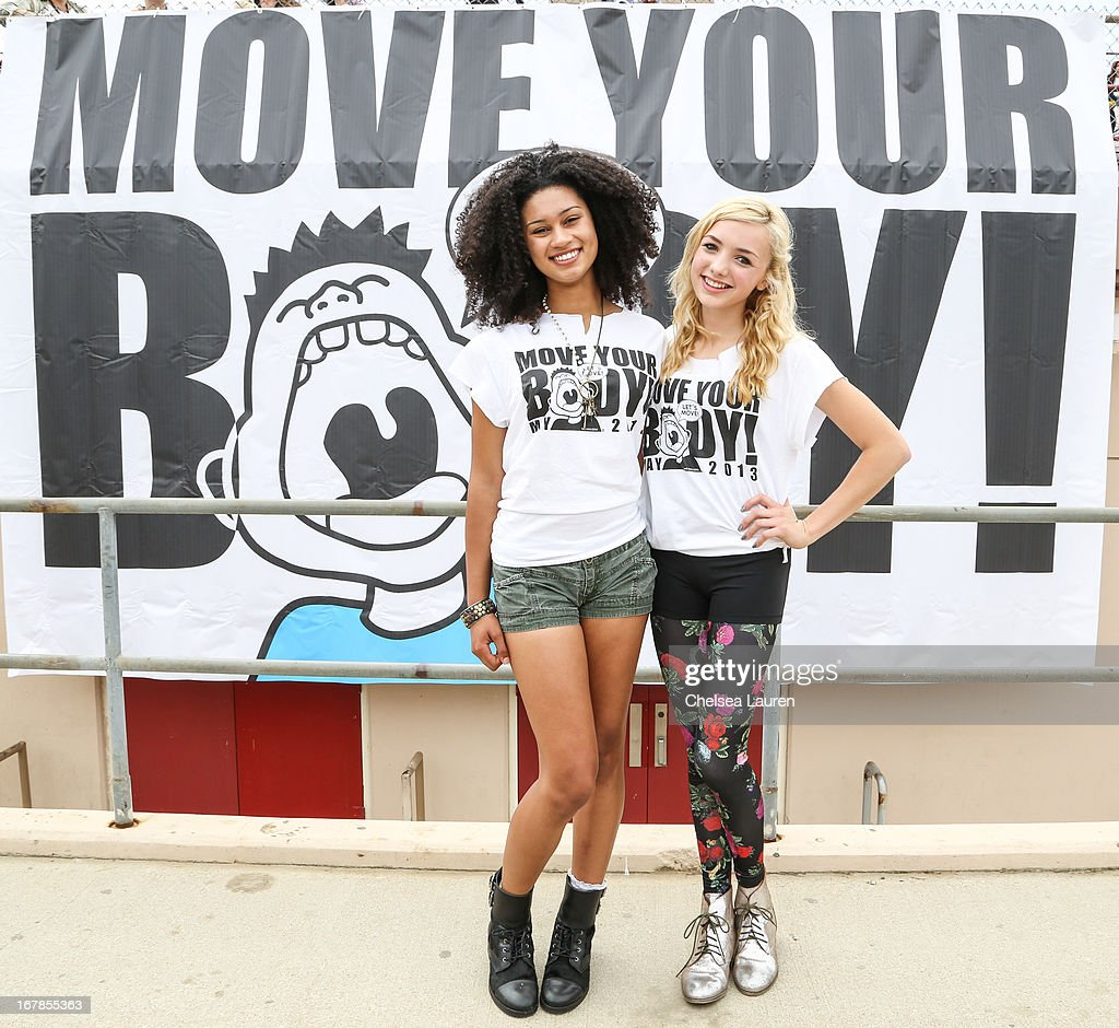 Actresses Michaela Blanks (L) and Peyton List attend the Michelle Obama And WAT-AAH! Foundation Move Your Body 2013 at Hollywood High School on May 1, 2013 in Los Angeles, California.