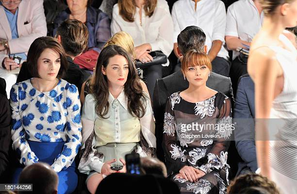 Actresses Michelle Dockery and Christina Ricci attend the Carolina Herrera fashion show during MercedesBenz Fashion Week Spring 2014 at The Theatre...