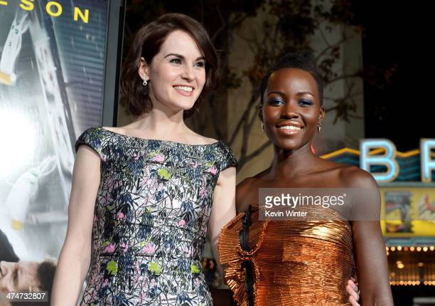 Actresses Michelle Dockery and Lupita Nyong'o attend the premiere of Universal Pictures and Studiocanal's 'NonStop' at Regency Village Theatre on...
