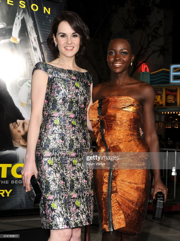 Actresses <a gi-track='captionPersonalityLinkClicked' href=/galleries/search?phrase=Michelle+Dockery&family=editorial&specificpeople=4047702 ng-click='$event.stopPropagation()'>Michelle Dockery</a> (L) and <a gi-track='captionPersonalityLinkClicked' href=/galleries/search?phrase=Lupita+Nyong%27o&family=editorial&specificpeople=10961876 ng-click='$event.stopPropagation()'>Lupita Nyong'o</a> attend the premiere of Universal Pictures and Studiocanal's 'Non-Stop' at Regency Village Theatre on February 24, 2014 in Westwood, California.