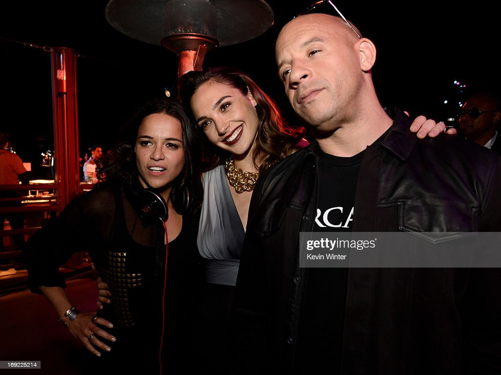 Actresses Michelle Rodriguez, Gal Gadot and actor/producer Vin Diesel pose at the after party for the premiere of Universal Pictures' 'Fast & Furious 6' at the Gibson Amphitheatre on May 21, 2013 in Universal City, California.