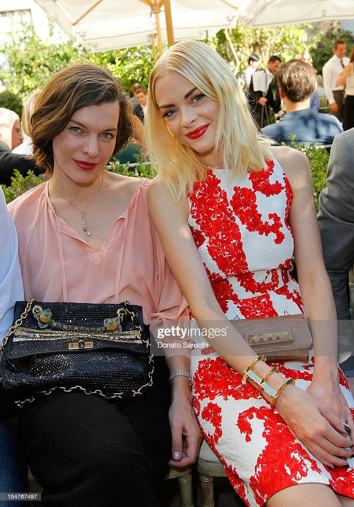 Actresses Milla Jovovich and Jaime King attend CFDA/Vogue Fashion Fund Event hosted by Lisa Love and Mark Holgate and sponsored by Audi, Beauty.com, American Express, and J Brand at Chateau Marmont on October 25, 2012 in Los Angeles, California.