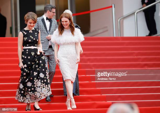 Actresses Millicent Simmonds and actress Julianne Moore walk in front of screenwriter Brian Selznic as they leave the 'Wonderstruck' screening during...