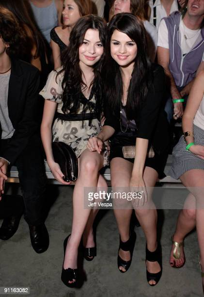 Actresses Miranda Cosgrove and Selena Gomez pose during the 7th Annual Teen Vogue Young Hollywood Party held at Milk Studios on September 25 2009 in...