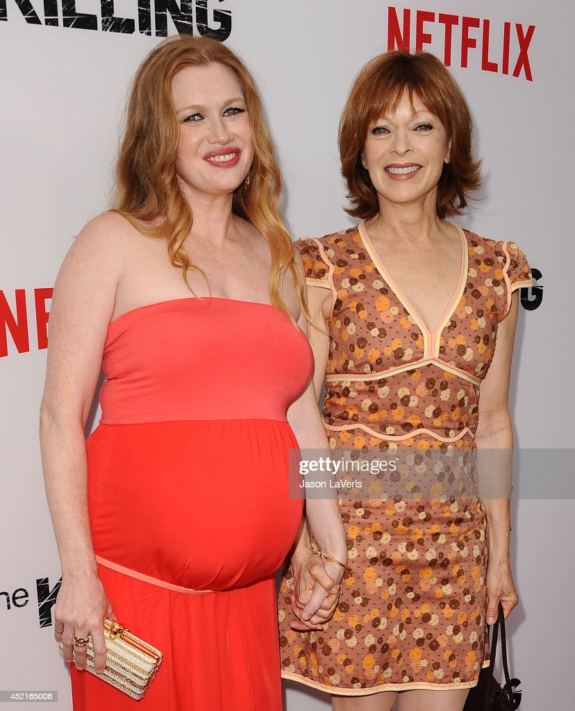 Actresses Mireille Enos and Frances Fisher attend the season 4 premiere of 'The Killing' at ArcLight Hollywood on July 14 2014 in Hollywood California