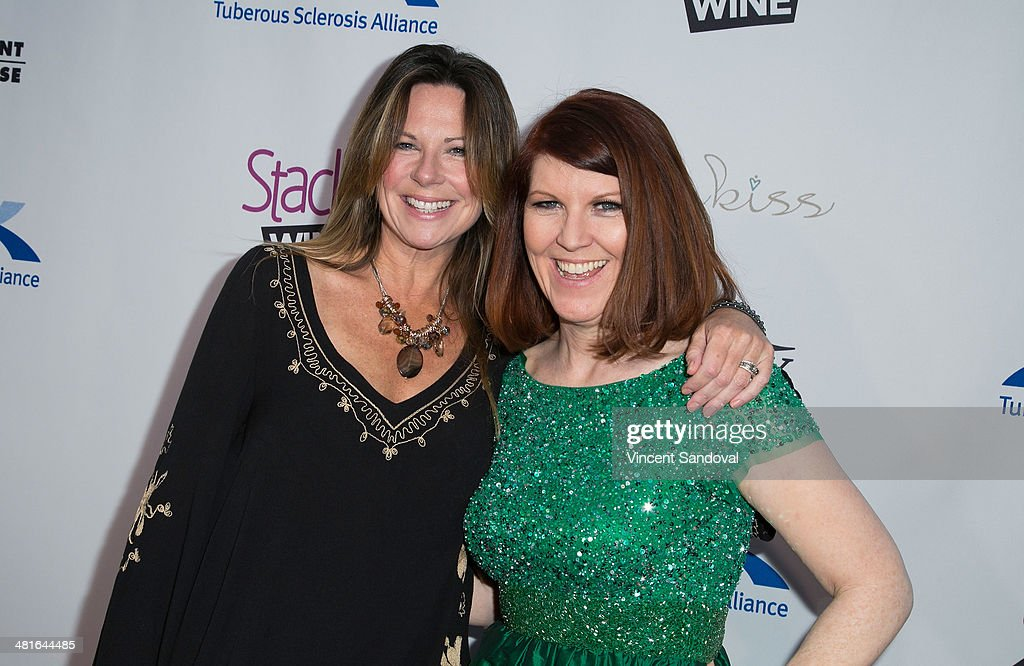 Actresses Mo Collins (L) and Kate Flannery attend the Tuberous Sclerosis Alliance's Comedy For A Cure benefit at Lure on March 30, 2014 in Hollywood, California.