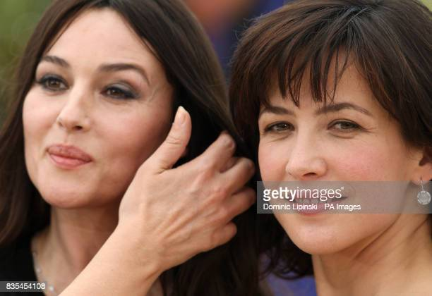 Actresses Monica Bellucci and Sophie Marceau attend a photocall for their film 'Don't Look Back' at the Palais des Festivals in Cannes France at the...