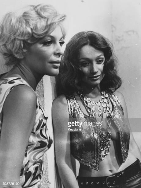 Actresses Monica Strebel and Francois Prevost in a scene from the film 'Brucia ragazzo brucia' at Cinecitta Studios Rome circa 1970