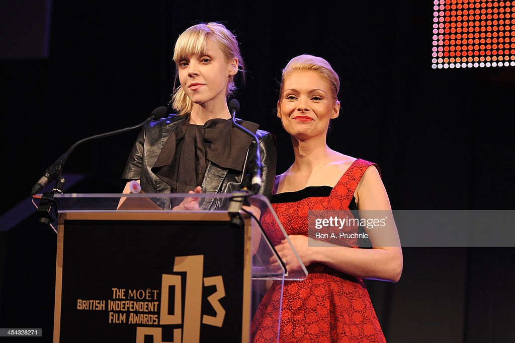 Actresses MyAnna Buring (R) and Antonia Campbell-Hughes present the award for Best Supporting Actress during the ceremony for the Moet British Independent Film Awards at Old Billingsgate Market on December 8, 2013 in London, England.
