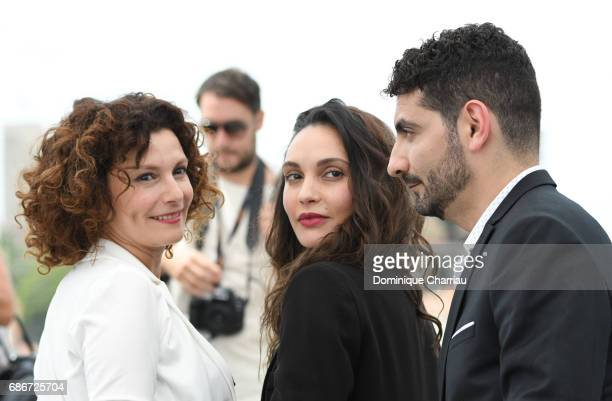 Actresses Nadia Kaci Hania Amar and director Karim Moussaoui attend 'Waiting For Swallows ' photocall during the 70th annual Cannes Film Festival at...