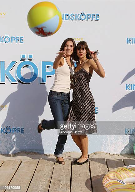 Actresses Nadine Warmuth and Susan Hoecke attend the Beach BBQ for the German Premiere of 'Kindskoepfe' at O2 World on July 30 2010 in Berlin Germany