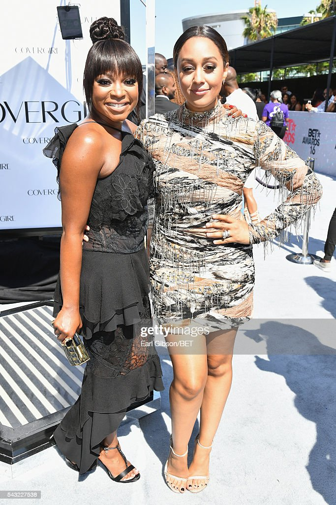 Actresses Naturi Naughton and Tia MowryHardrict attend the Cover Girl glam stage during the 2016 BET Awards at the Microsoft Theater on June 26 2016...