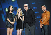 Actresses Neve Campbell and Emma Roberts director Wes Craven and actor David Arquette speak onstage during Spike TV's 'Scream 2010' at The Greek...