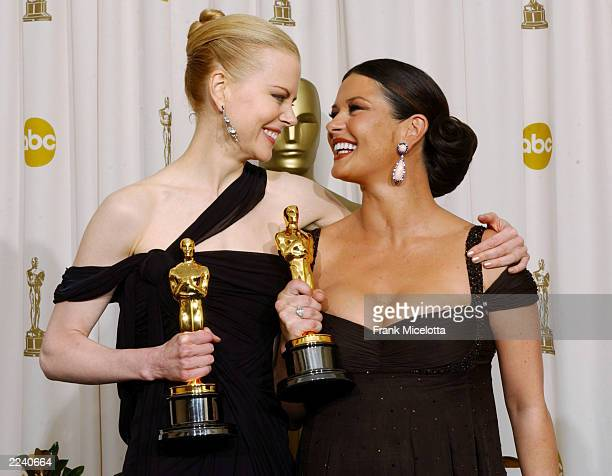 Actresses Nicole Kidman and Catherine ZetaJones pose with their awards during the 75th Annual Academy Awards at the Kodak Theater on March 23 2003 in...