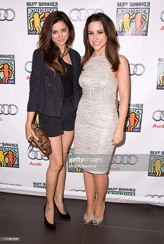 Actresses Noureen DeWulf and Lacey Chabert attend the Best Buddies poker event at Audi Beverly Hills on August 22, 2013 in Beverly Hills, California.