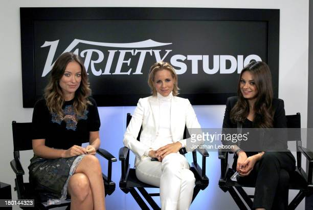Actresses Olivia Wilde Maria Bello and Mila Kunis speak at the Variety Studio presented by Moroccanoil at Holt Renfrew during the 2013 Toronto...