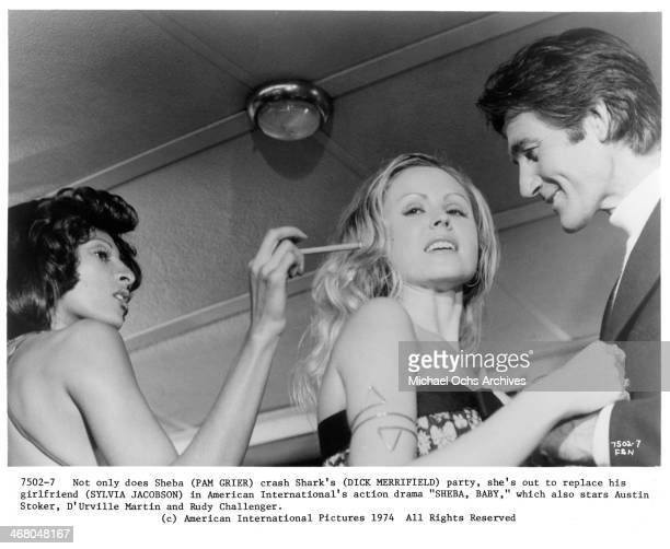Actresses Pam Grier Sylvia Jacobson and actor Dick Merrifield on set of the movie ''Sheba Baby ' circa 1975