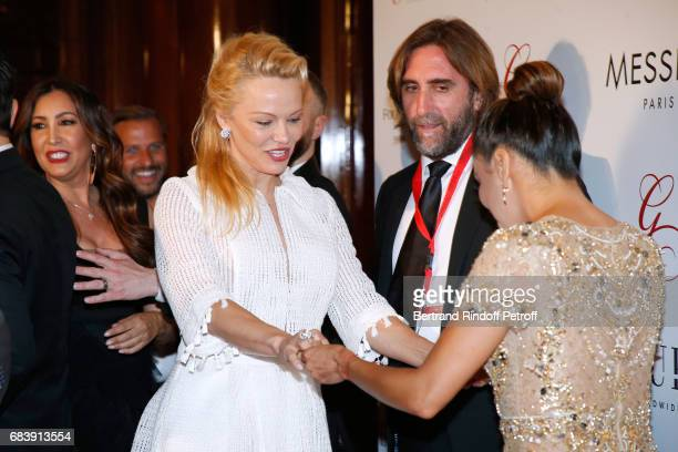 Actresses Pamela Anderson and Eva Longoria attend the 'Global Gift the Eva Foundation' Gala Photocall at Hotel George V on May 16 2017 in Paris France