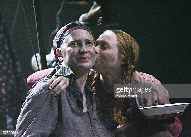 Actresses Pamela Rabe and Hayley McElhinney perform during a media call for 'Mother Courage And Her Children' at the Sydney Theatre Company on May 16...